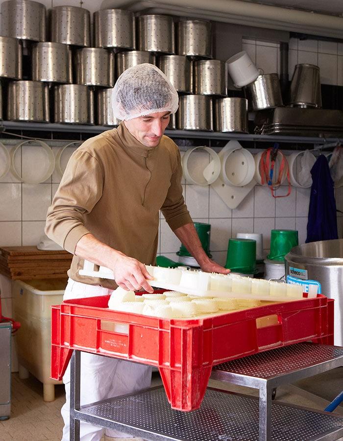 goat farm in switzerland, Toni Odermatt making goat cheese