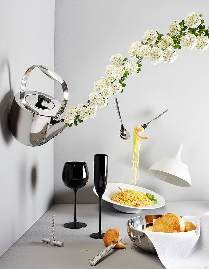 flying  dinnerware on grey background